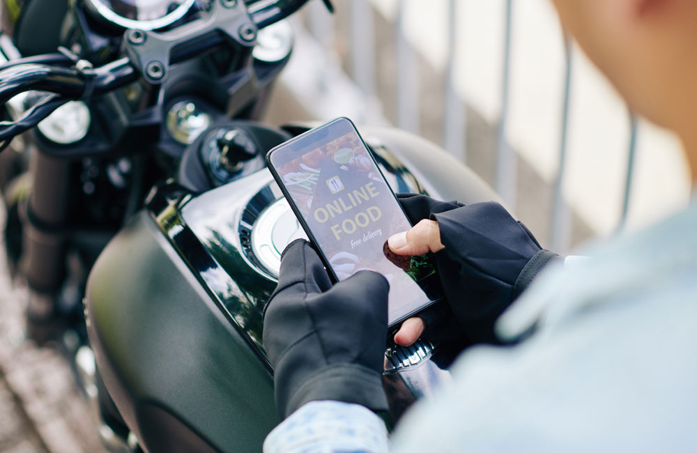 motorcyclist-ordering-food-using-online ordering-system-foodship